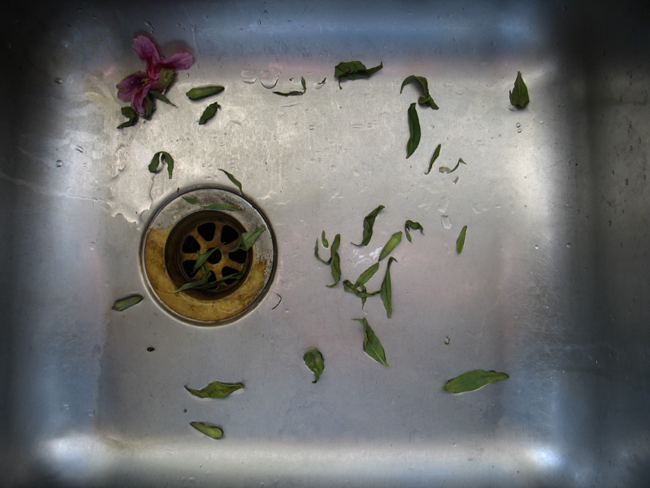 Washing away debris into gutter