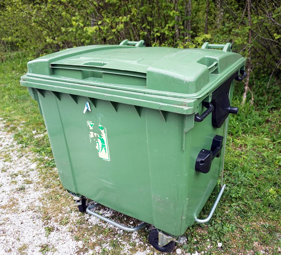 Sealed green trash bin